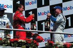 The podium: champagne for Michael Schumacher, Juan Pablo Montoya and Ralf Schumacher