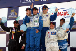 The LMP 675 podium: winners Chris McMurry, Bryan Willman and Jeff Bucknum with Marc-Antoine Camirand, Ben Devlin, Melanie Paterson and Paul Fix