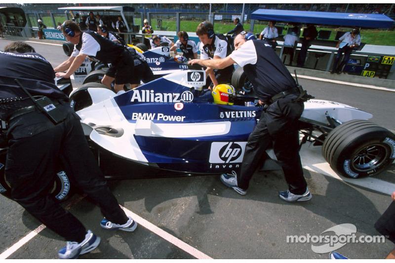 Ralf Schumacher and Juan Pablo Montoya back to the pits