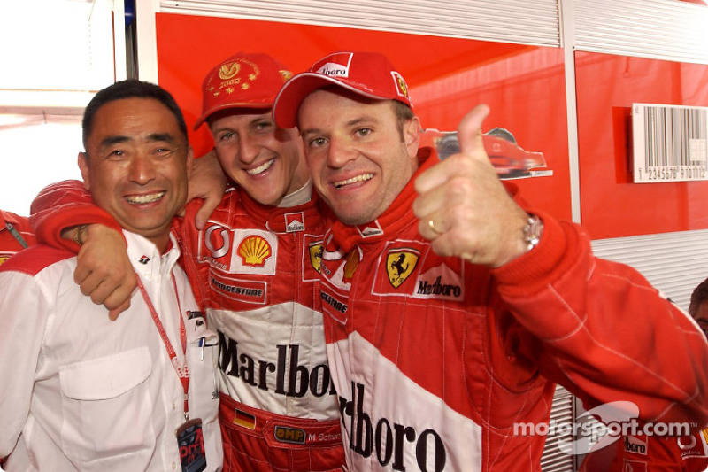 Race winner Rubens Barrichello with Michael Schumacher and Mr. Yasukawa