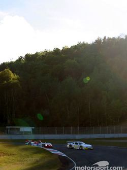 Fredy Lienhard passes Sky Blue Racing Mustang