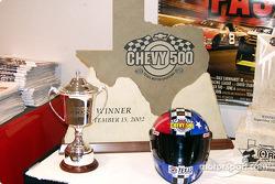 Winners trophy and pole winners helmet
