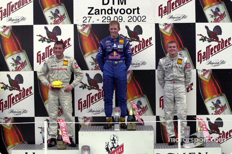 The podium: race winner Mattias Ekström with Bernd Schneider and Marcel Fassler