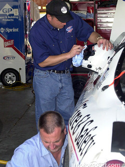 Tim Sauter polishes his helmet