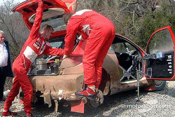 Harri Rovanpera and Risto Pietilainen desperatly try to repair the Peugeot