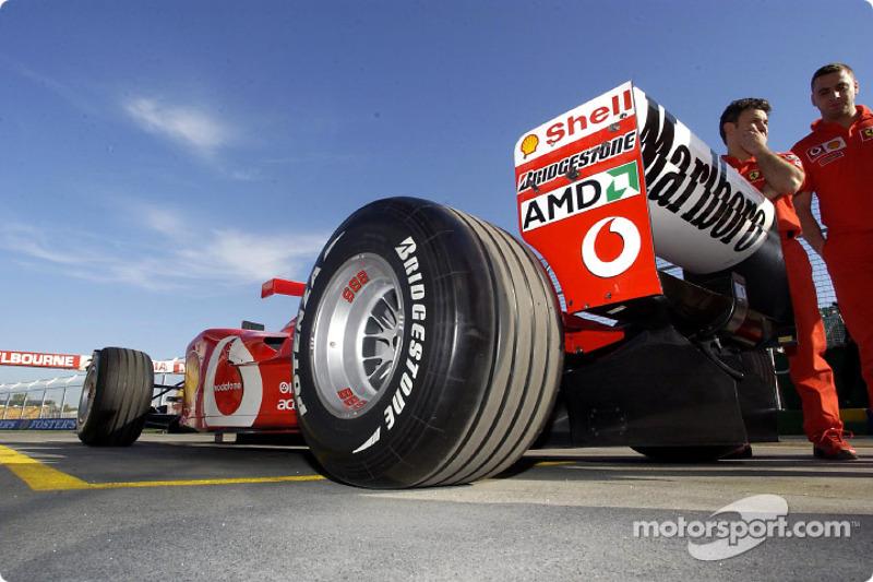 Ferrari team members head to technical inspection