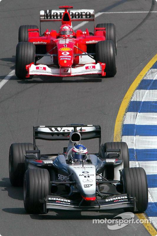 Kimi Raikkonen leads Michael Schumacher