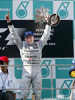 The podium: race winner Kimi Raikkonen