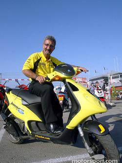 Eddie Jordan on his Piagio moped