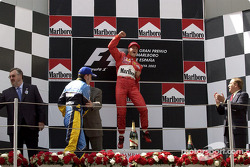 The podium: race winner Michael Schumacher with Fernando Alonso