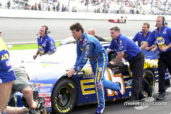 Michael Waltrip helps to push the car