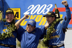 Petter Solberg and codriver Phil Mills celebrate victory with STI president Mr Katsurada