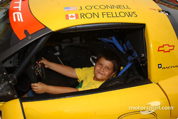 A future racing star checks out the Chevrolet Corvette of Ron Fellows and Johnny O'Connell