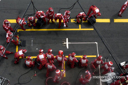 Ferrari team members wait for Rubens Barrichello