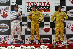 The podium: race winner A.J. Allmendinger with Aaron Justus and Jonathan Macri