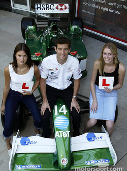 Mark Webber is pictured with students Laura Taylor and Kate Nield at their local HSBC branch in Milton Keynes