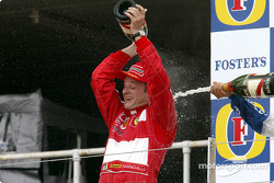 The podium: champagne for race winner Rubens Barrichello