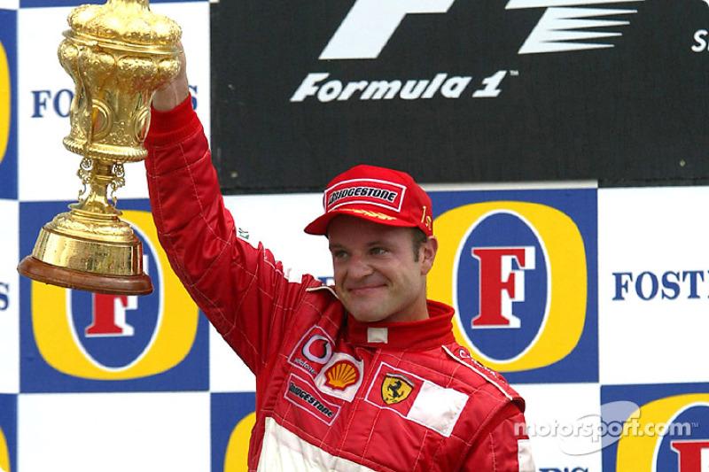 Подіум: переможець гонки Рубенс Баррікелло