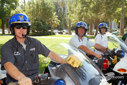 American Le Mans Series drivers Gunnar Jeannette, J.J. Lehto and Jeff Bucknum pretend they are California Highway Patrol officers