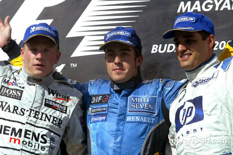 Podio: ganador de la carrera de Fernando Alonso con Kimi Raikkonen y Juan Pablo Montoya