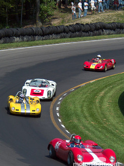 #64 1964 Brabham BT8, owned by Mark Simpson leads a pack of group 5 cars