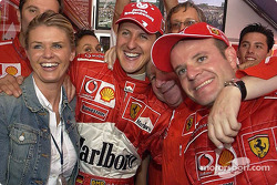 Race winner Michael Schumacher celebrate with wife Corinna, Jean Todt and Rubens Barrichello