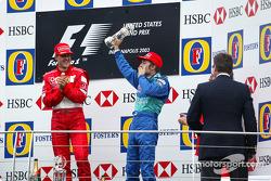 Podium: race winner Michael Schumacher with Heinz-Harald Frentzen
