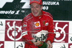 Podium: champagne for Rubens Barrichello