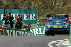 Photographers snap series leader Marcos Ambrose through the Dipper