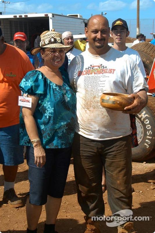 Hawaii sprinter Gary Costa receives his third place Trophy Dash koa bowl from Ginger Apana