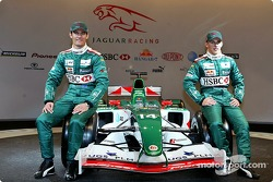Mark Webber and Christian Klien pose with the new Jaguar R5