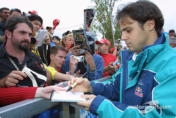 Felipe Massa signs autographs