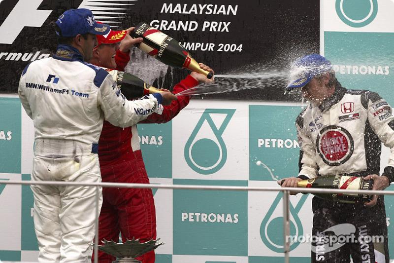 Podium: champagne for Michael Schumacher, Juan Pablo Montoya and Jenson Button