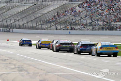 Cars wait on pit lane to practice