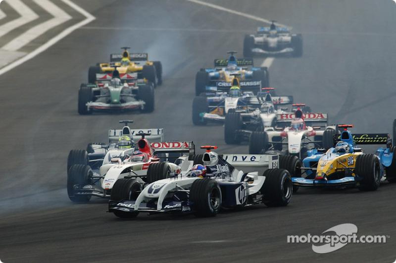 Start: Juan Pablo Montoya, Williams FW26; Takuma Sato, BAR 006; Jarno Trulli, Renault R24