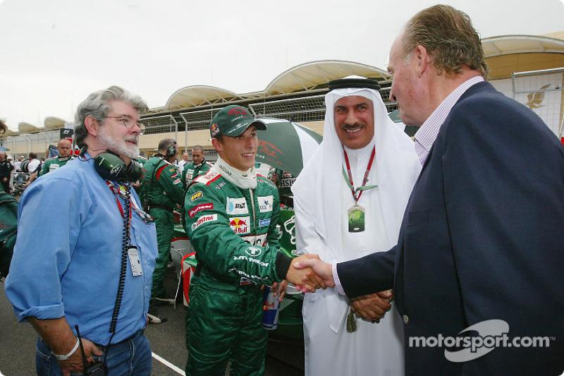 Le réalisateur George Lucas, Christian Klien et le Roi Juan Carlos d'Espagne sur la grille de départ