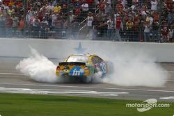 Race winner Elliott Sadler smokes the tires