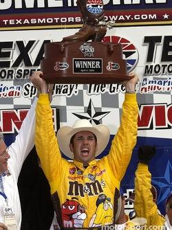 Race winner Elliott Sadler celebrates