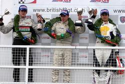 Podium: race winner Adam Carroll with Nelson A. Piquet and James Rossiter