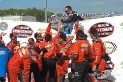 Jack Sprague's IWX team receives congratulations from a Dennis Setzer crew member