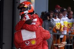 Race winner Michael Schumacher celebrates victory with Ross Brawn