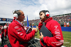 Olivier Panis's race engineer Humphrey Corbett consults with Chief Race Engineer Dieter Gass on the starting grid