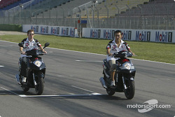 Anthony Davidson and Takuma Sato ride their Honda bike around Hockenheim