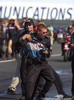 Tim Wilkerson's crew celebrates after winning the Funny Car finals