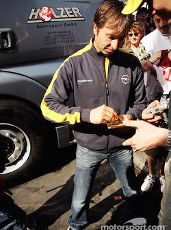 Heinz-Harald Frentzen signs autographs