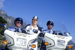 Jenson Button and members of the local police force