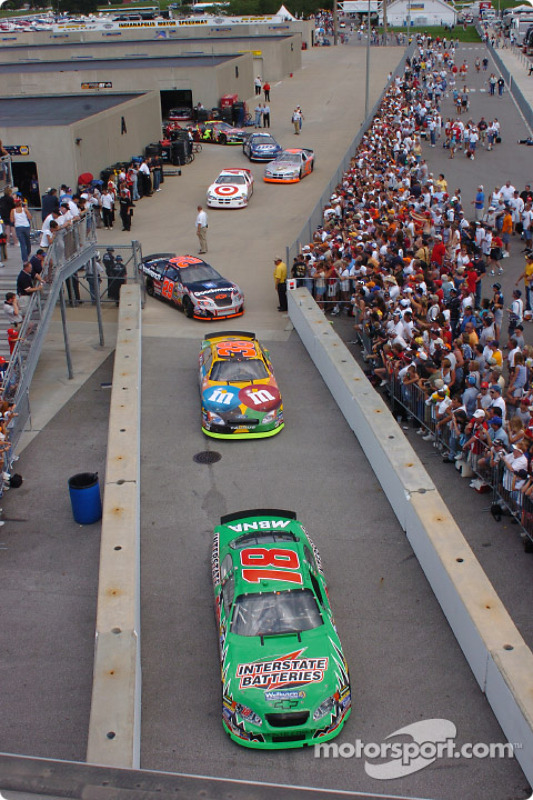 Cars head to the track