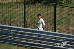 Felipe Massa waits on the trackside