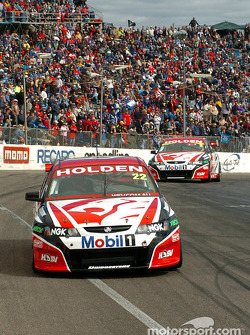 Todd Kelly passes team mate and pole sitter Mark Skaife