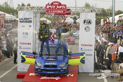 Podium: champagne for rally winners Petter Solberg and Phil Mills